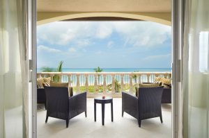 Luxurious veranda with a view of the Caribbean Ocean.